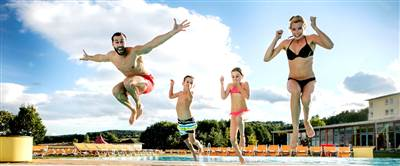 Family jumps into pool at a thermal bath